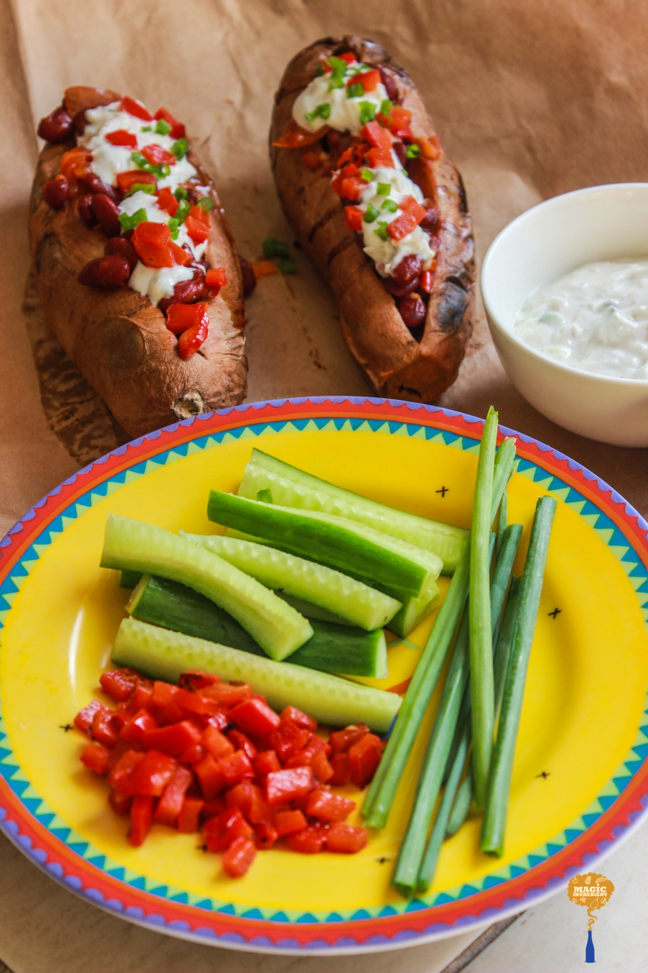 photo of Baked sweet potato with beans and tzatziki sauce