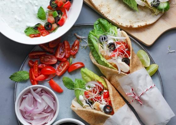 photo of Tzatziki sauce and gyros(Greek sandwich)