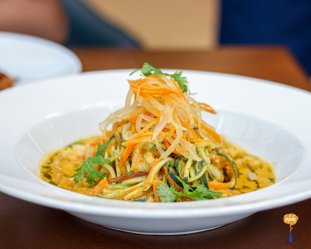 photo of Thai prawn curry with zoodles and crunchy pickled papaya salad