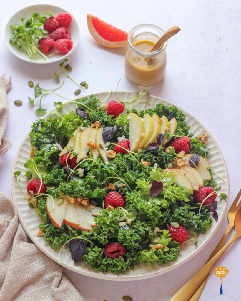 Photo of Raspberry pear and kale salad with grapefruit dressing